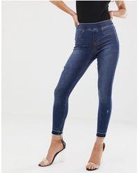 Spanx – Formende und anhebende, enge Jeans mit Abnutzungserscheinungen - Blau