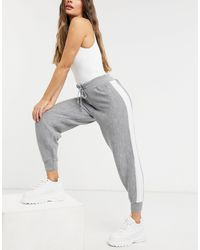 UNIQUE21 - Joggers deportivos grises con raya lateral - Lyst