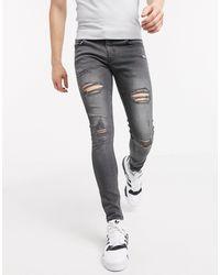 New Look - Jeans super skinny strappati grigi - Lyst