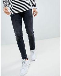 River Island Jeans skinny nero slavato