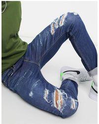 Levi's Youth 512 – Lo-Ball – Schmal zulaufende Jeans im Used-Look - Blau