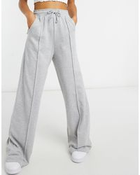 In The Style X Megan Mckenna - Joggers a vita alta con fondo ampio grigi - Grigio