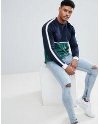 ASOS T-shirt long décontracté en tissu à manches longues avec empiècement contrastant et ourlet arrondi - Vert