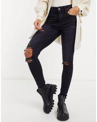 American Eagle Jean skinny taille haute avec déchirures aux genoux - Noir
