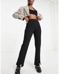 Y.A.S Pantalones s con abertura en la parte delantera - Negro