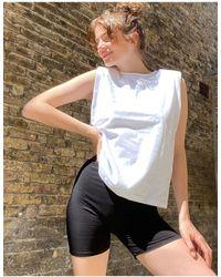 AllSaints Coni - Top senza maniche con spalle imbottite bianco