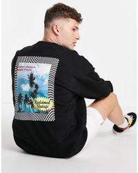 Reclaimed (vintage) Inspired - Sweat-shirt à motif palmier en coton biologique - Noir