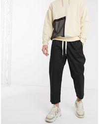 Reclaimed (vintage) Pantaloni cropped comodi neri - Nero