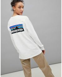 Patagonia - P-6 Back Logo Long Sleeve Top In White - Lyst