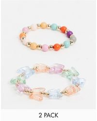 ASOS Pack Of Two Beaded Bracelets With Pastel Butterfly Charms - White