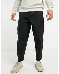 ASOS Pantalon chino fuselé oversize - Noir