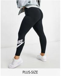 Nike Leggings negros con logo en el tobillo