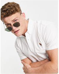 Abercrombie & Fitch 3D Icon - Camicia Oxford a maniche corte con logo bianca - Bianco