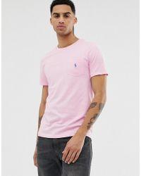 Polo Ralph Lauren T-shirt rosa con tasca e logo del giocatore