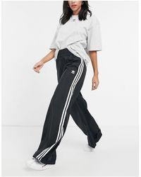 adidas Originals – Bellista – e Hose mit weitem Bein und drei Streifen - Schwarz