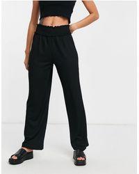 Vero Moda – Hose mit weitem Bein und elastischem Bund - Schwarz