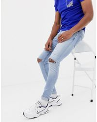 Love Moschino Skinny Jeans With Ripped Knees - Blue