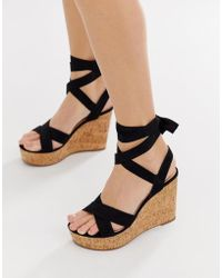 6c34904613c Truffle Collection Wide Fit Pom Espadrille Wedge in Black - Lyst
