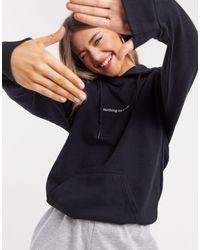 In The Style X Jac Jossa - Sweat-shirt à capuche style loungewear avec inscription sur le devant - Noir