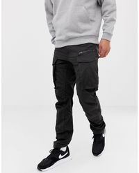 G-Star RAW Pantalones cargo tapered negros en 3D con cremallera Rovic