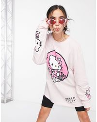 New Girl Order X Hello Kitty Oversized Long Sleeve T-shirt With Front And Sleeve Graphic - Pink