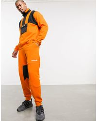 adidas Originals Adventure Fleece joggers - Orange