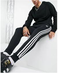 adidas Originals - Черные Джоггеры Скинни С Тремя Полосками Adicolor-черный - Lyst