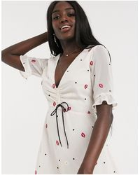 Finders Keepers Chi Chi Lips And Daisy Print Mini Dress - Multicolour