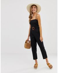 a4fa8ecc350 Lyst - ASOS Wrap Front Belted Jumpsuit In Velvet in Pink