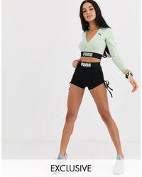 PUMA – Booty – e Shorts, exklusiv bei ASOS - Schwarz