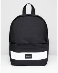 ASOS DESIGN - Mini Backpack In Black With Front Logo - Lyst