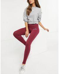 The Couture Club Legging taille haute avec imprimé contour du logo - Rouge
