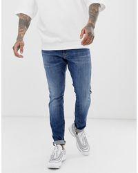 G-Star RAW Jean skinny effet vieilli moyen - Bleu