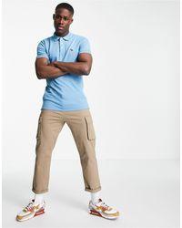 Abercrombie & Fitch Polo jaspeado con logo 3d - Azul