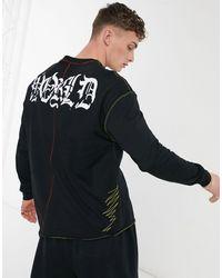 Bershka T-shirt a maniche lunghe nera con stampa - Nero