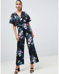 0757a26579a Lyst - Club L One Shoulder Cape Sleeve Detailed Jumpsuit in Black