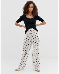 ASOS – Pyjamahose mit Dreieckmuster aus Bio-Baumwolle - Schwarz