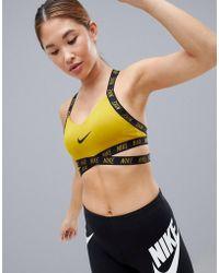 Nike - Indy Logo Bra In Mustard - Lyst