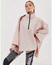 81db539660 Training Poncho In Pink