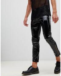 ASOS – Stefan – Enge Jeans aus schwarzem Vinyl mit Reißverschluss am Saum
