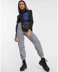Nicce London Chaleco utilitario con bolsillos reflectantes - Negro