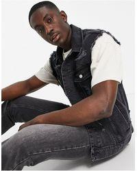 ASOS Gilet di jeans con strappi nero slavato