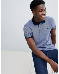Hollister - Polo Stretch Pique Icon Logo Slim Fit In Navy Oxford - Lyst
