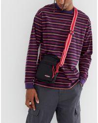 Eastpak The One - Borsello da 2,5 L nero con tracolla a contrasto