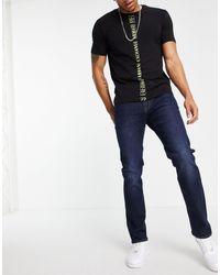 Armani Exchange J13 - Jeans slim lavaggio medio scuro - Blu