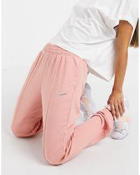 Nike Mini Metallic Swoosh Oversized joggers - Pink