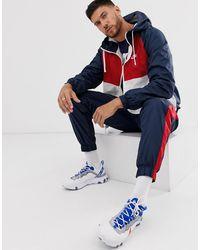 Nike – Gewebter, dreifarbiger Trainingsanzug - Blau
