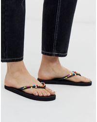 Accessorize Black Flip Flops With Neon Beaded Trim