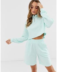 ASOS Conjunto de pantalones cortos y sudadera con cremallera confort - Azul