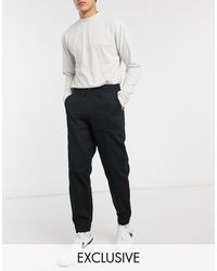 Collusion Joggers negros tapered